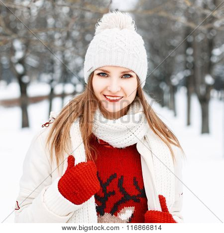 Close-up Winter Portrait Of Beautiful Girl In Fashionable Warm Clothes On A Background Of Snowy Tree