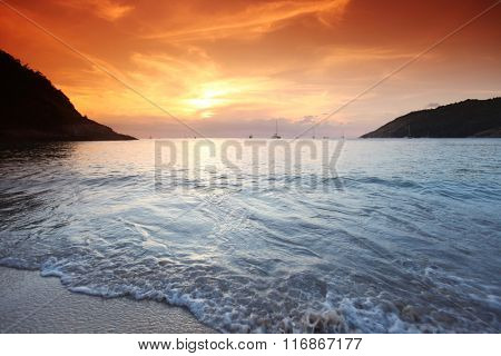 Beautful landscape with sea beach and mountains under sunset sky in Thailand