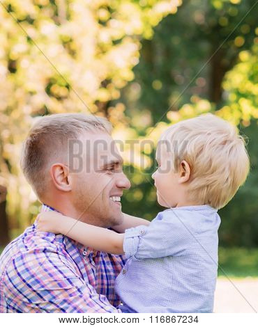 Young dad spending time with his son in the park.