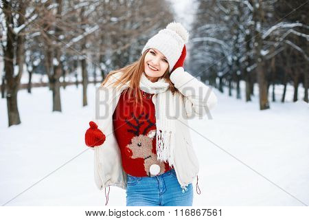 Young Stylish Girl In A Warm Winter Clothes Walking In A Winter Snowy Day