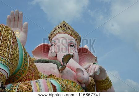 elephant head god statue in pink on Buddhist temple