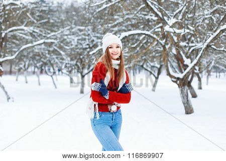 Young Fashionable Girl In A Warm Vintage Winter Clothes In Winter Snowy Day.