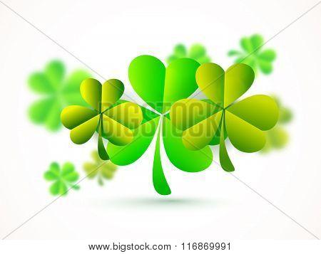 Creative glossy shamrock leaves for Happy St. Patrick's Day celebration.