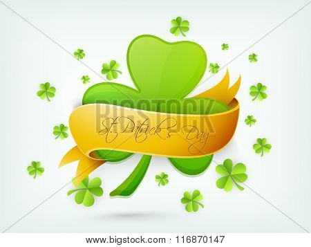 Beautiful Shamrock Leaf covered by glossy golden ribbon for Happy St. Patrick's Day celebration.