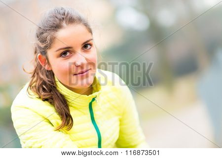 Beautiful Girl Potrait With A Yellow Sports Jacket Feather