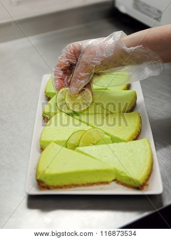 Confectioner is decorating lime cake