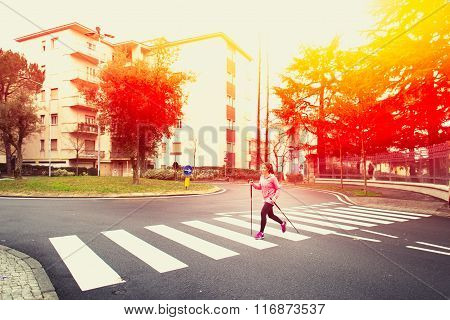 Girl Practicing Nordic Walking In The City, Passing The Pedestrian Crossing