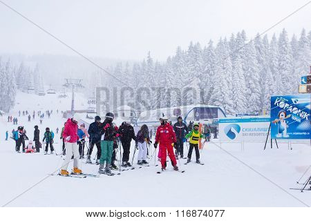 Panorama of ski resort Kopaonik, Serbia, skiers, lift, pine trees