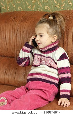 The Girl Communicates By The Mobile Phone