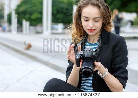 Photographer Sits On The Sidewalk