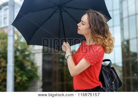 Girl Goes Under An Umbrella