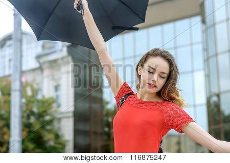 Woman Dancing Under An Umbrella