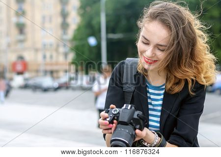 Tourist Looks At The Images Of The City