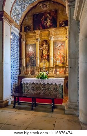 Obidos, Portugal - August, 2015: Saint Catherine Chapel with an altarpiece inside the medieval Santa Maria Church. Obidos is a medieval town inside walls, and very popular among tourists.