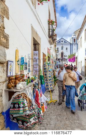 Obidos, Portugal. Direita Street, the main street of Obidos during the popular Medieval Market. Obidos is a medieval town still inside walls, and very popular among tourists.