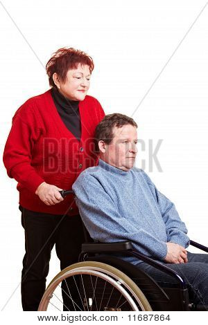 Elderly Woman Driving Her Man In Wheelchair