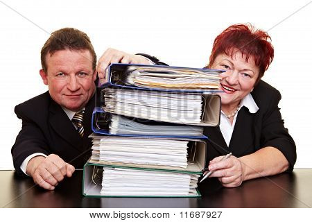 Two Senior Business People With Files
