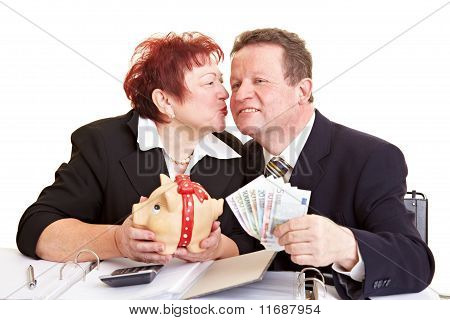Senior People With Money And Piggy Bank
