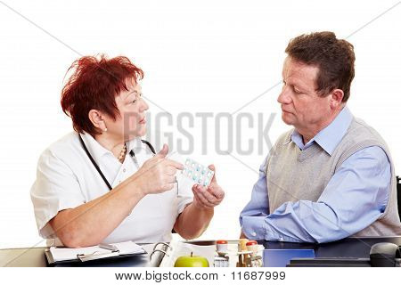 Female Doctor Explaining Medication To Patient