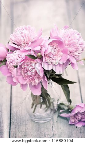 Spring background of pink peonies - retro styled photo
