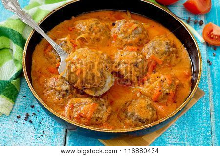 Homemade Meatballs In Tomato Sauce With Spices In A Rustic Style