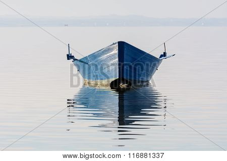 Bow Of The Boat Is Reflected In The Water