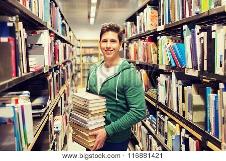 happy student or man with book in library