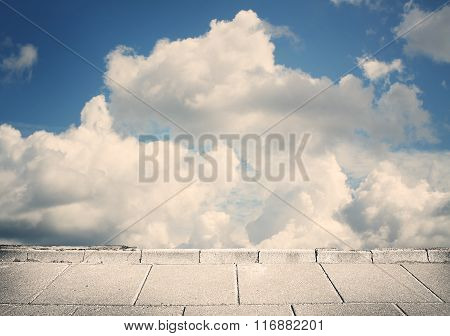 Grunge blue clouds, sky on concrete wall
