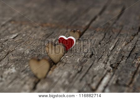 Valentine day. Hearts on a background of wood. Space for text.