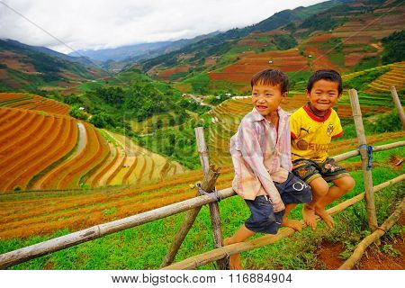 unidentified ethnic kids relaxing on the mountain when his parents are working on the terraces.