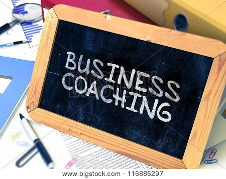 Handwritten Business Coaching on a Chalkboard.