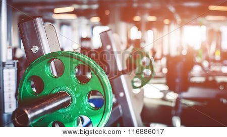 Rod with weights in the gym