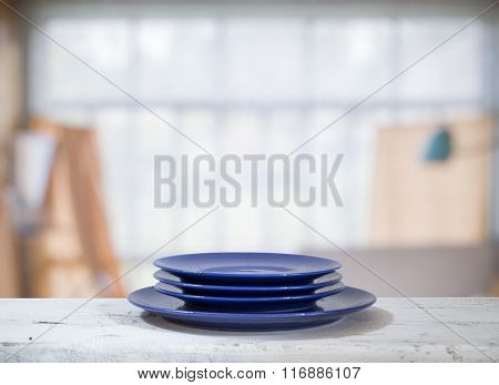 plates on white table in old room with big windows