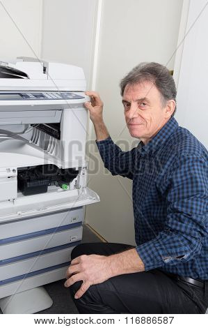 Male Technician Is Repairing Digital Photocopier Machine