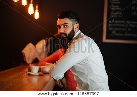 Young Business Man Behind The Bar With Coffee