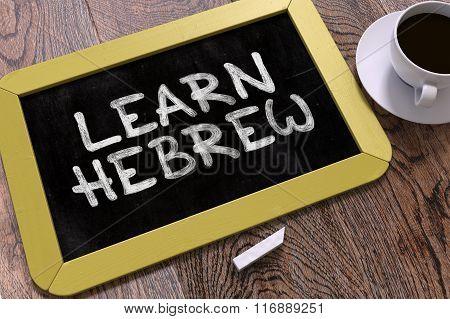 Hand Drawn Learn Hebrew Concept on Chalkboard.