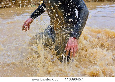 Close-up Of Man Making Splashes Of Dirty Water