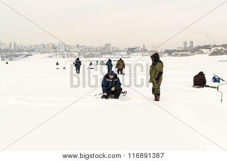 Russian Fishermen Ice Fishing In Winter