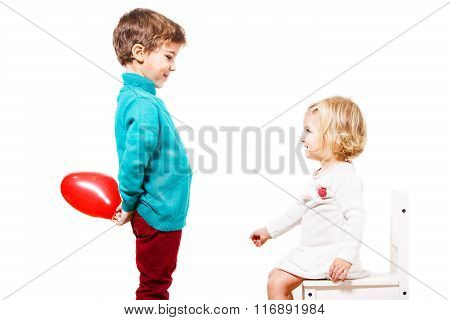 Boy  giving a red balloon to the girl