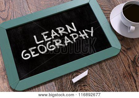 Learn Geography Handwritten on Chalkboard.