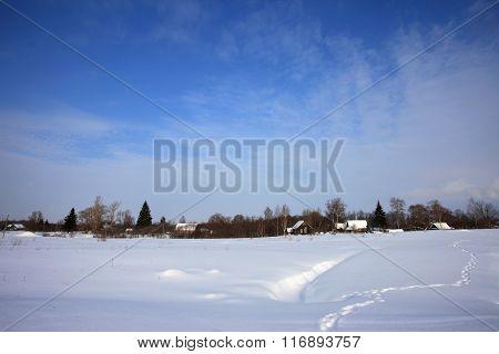 Winter snow rural landscape blue sky wooden houses in field