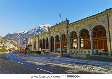 BAD RAGAZ SWITZERLAND - JANUARY 5 2015: Spa house with Cat statue and Mountains. Bad Ragaz is a city in St. Gallen in Switzerland over Graubunden Alps. Spa and recreation is at end of Tamina valley