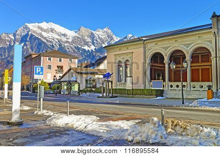 BAD RAGAZ SWITZERLAND - JANUARY 5 2015: Spa house with Cat statue and Mountain. Bad Ragaz is a city in St. Gallen in Switzerland over Graubunden Alps. Spa and recreation village is at Tamina valley