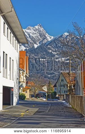 Street view on the Alps in the Town of Bad Ragaz. Bad Ragaz is a city in canton St. Gallen in Switzerland. It lies over Graubunden Alps. Spa and recreation village is at end of Tamina valley