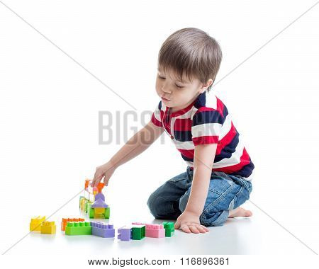 child boy playing block toys