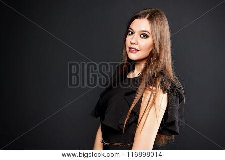 Portrait of beautiful woman in black dress