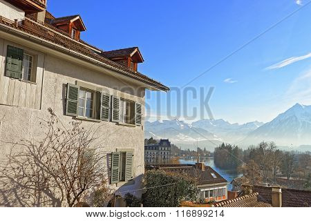 Panorama of the Thun Town with Thunersee and the Alps. Thun is a city in the canton of Bern in Switzerland where the Aare river flows out of Lake Thun. There is a view of Bernese Alps.