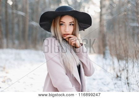 Portrait Of A Beautiful Young Woman In A Black Hat And A Vintage Coat In Cool Winter Day.