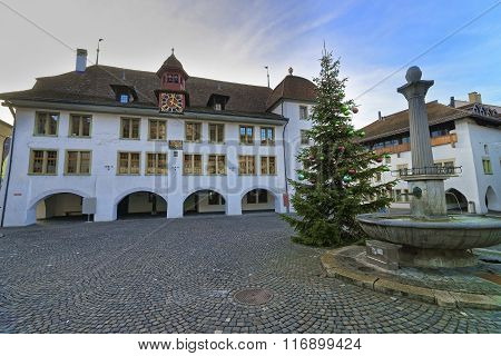 City Hall Christmas tree and Fountain in Thun Town Hall Square. Thun is a city in Swiss canton of Bern where the Aare river flows out of Lake Thun. Town Hall Square is a historic center of the city
