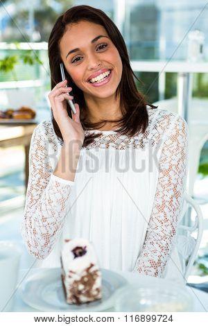 young girl calling while eating